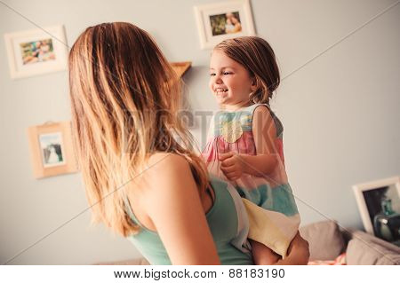 lifestyle capture of happy mother and daughter having fun at home