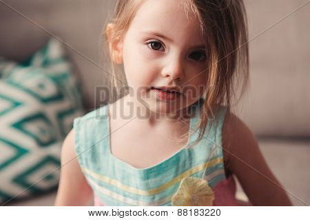 portrait of adorable toddler girl at home