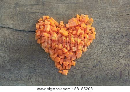Chopped Carrots Arranged In The Shape Of Heart