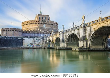 Saint Angel Castle And A Bridge Over The Tiber River In Rome.