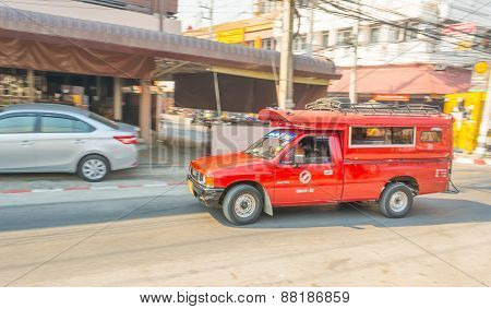 Blur Image Of Unidentified Driver And Tourists In Red Car Vehicle