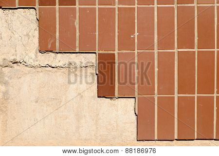 Wall of a buiding half covered with brown tiles a lot of copyspace