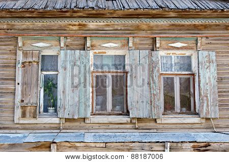 Three old russian style wooden window in Astrakhan, Russia. Urban decay. Heritage.