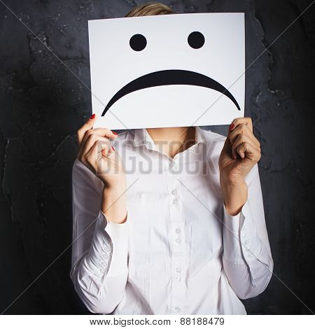Woman Holding Frames With Sad Faces