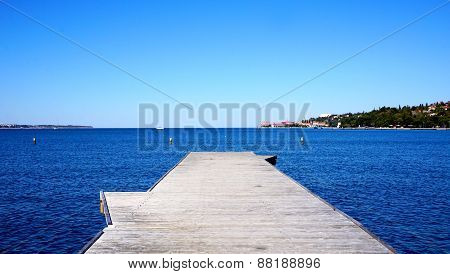 Bridge To The Sea With Blue Sky