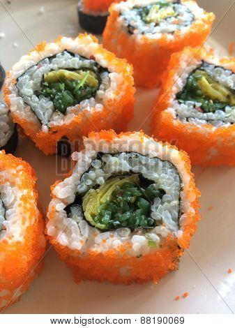 California Maki Sushi With Masago - Roll Made Of Crab Meat, Japanese Omelette, Seaweed Inside. Masag