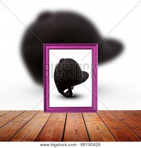 Jockey Black Helmet In Frame On Wood