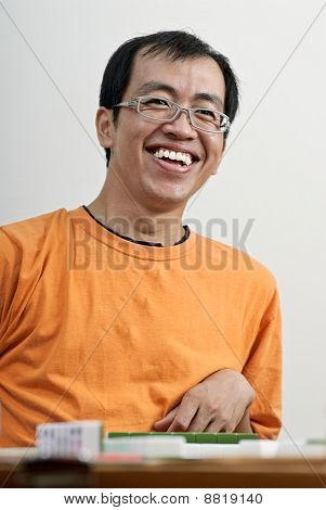 Happy Smiling Asian Man Play Mahjong