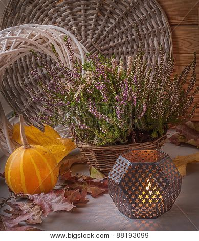 Heather In A Basket Next To A Candle