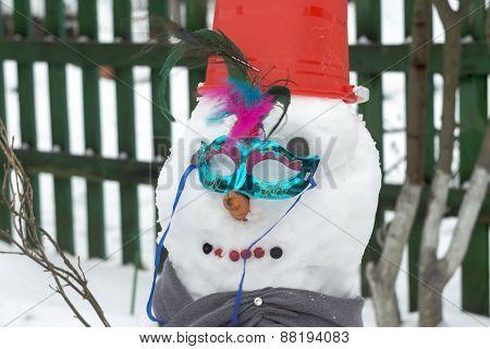 Snowman In Red Bucket