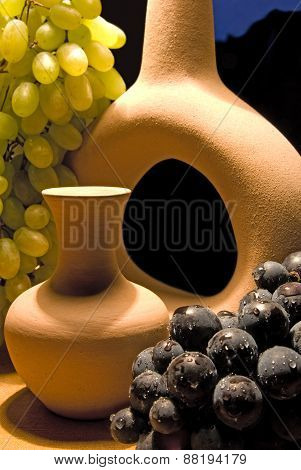 Composition with dark and light grapes