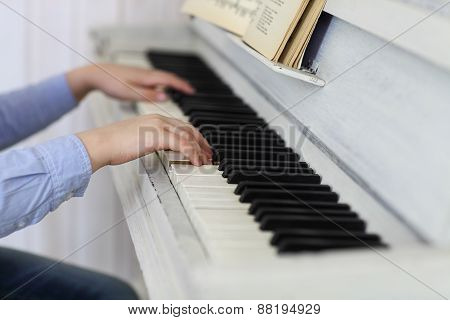 Close Up Of Hands Playing Piano. Concept Of Music And Entertainment
