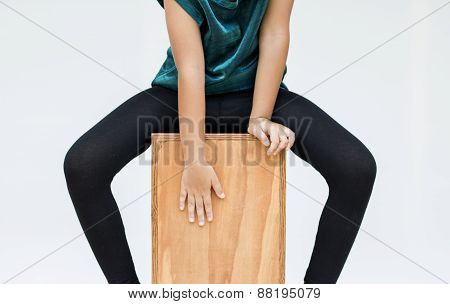 Playing A Cajon Percussion Instrument