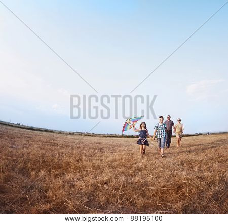 Family Playing With Kite