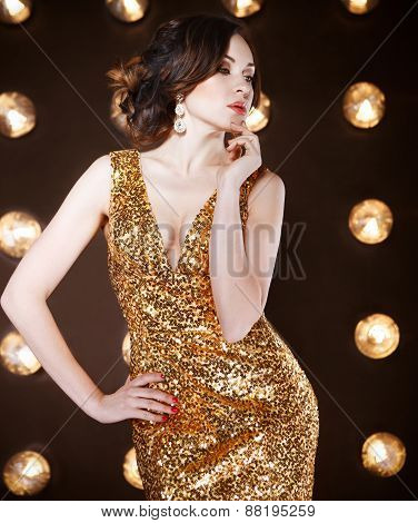 Superstar Woman Wearing Golden Shining Dress