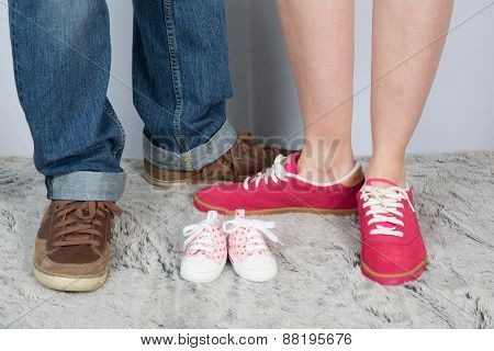 Mother And Father With Nice Shoes And Baby Shoes