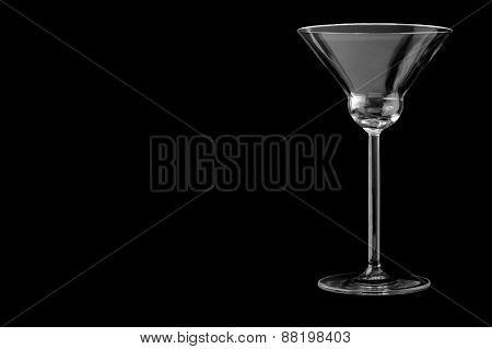 Martini empty glass on a black background