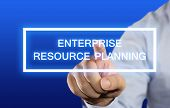 image of enterprise  - Business concept image of a businessman clicking Enterprise Resource Planning button on virtual screen over blue background - JPG