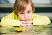 foto of sad boy  - Close up portrait of a sad little boy - JPG