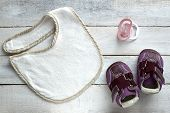 picture of pacifier  - Some things baby in a wooden white - JPG