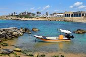 picture of crusader  - fishing boat at ancient port Caesarea - JPG