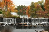 image of dam  - Falls at the dam in Townsend, MA, with foliage in the background
