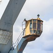 foto of dock  - Particular of an Old crane at the dock of the port - JPG