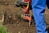 image of plow  - Closeup of hand motor plow blade throwing clay - JPG
