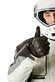 stock photo of driver  - Mature race driver showing ok sign - JPG