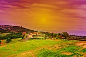 image of farmhouse  - Big Farmhouse Surrounded by Fields in Tuscany at Sunset - JPG