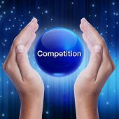 stock photo of stress-ball  - Hand showing blue crystal ball with competition word - JPG