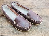 stock photo of shoes colorful  - leather lady shoe brown color with stitch decoration on wooden floor - JPG