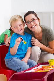 foto of student teacher  - a happy preschool  teacher with young student in classroom - JPG