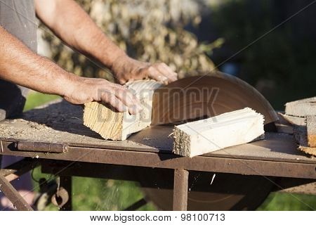 Carpenter working on woodworking machines