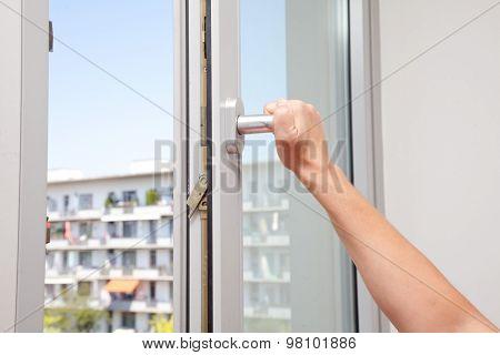 Woman Tilting Window