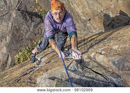 Aged rock climber