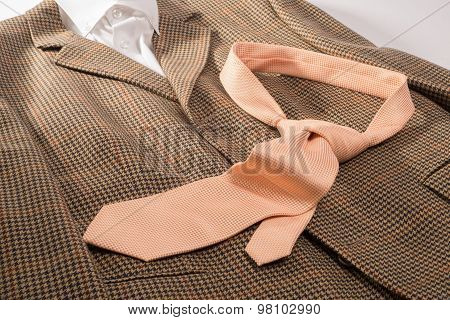 Orange Tie On Brown Jacket And White Shirt