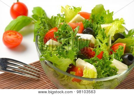detail of fresh vegetable salad in glass bowl