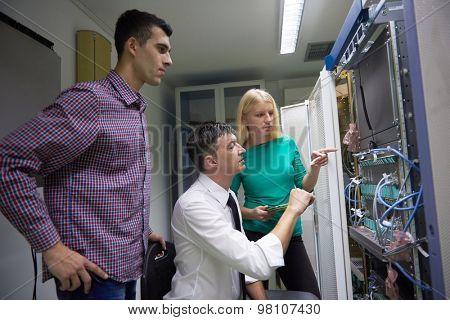 business people group, network engeneers working in network server room on tablet computer