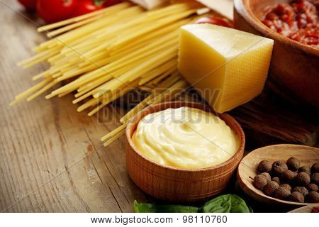 Pasta spaghetti with tomatoes, sauce bolognese, cheese and basil on rustic wooden  background