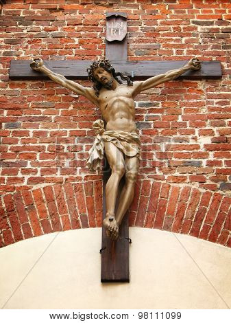Crucifixion of Christ on a brick wall