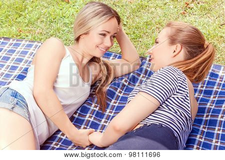 Lesbian couple during picnic in park