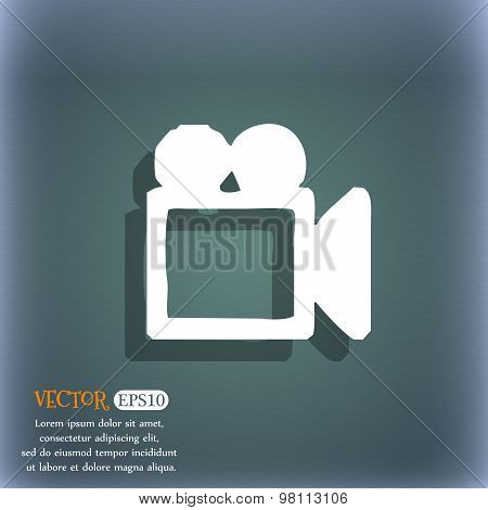 Camcorder Icon Symbol On The Blue-green Abstract Background With Shadow And Space For Your Text. Vec