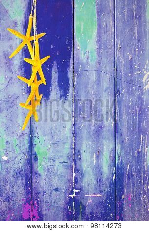 Yellow starfish on blue