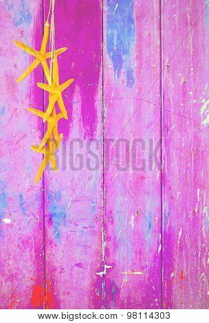 Yellow starfish on pink