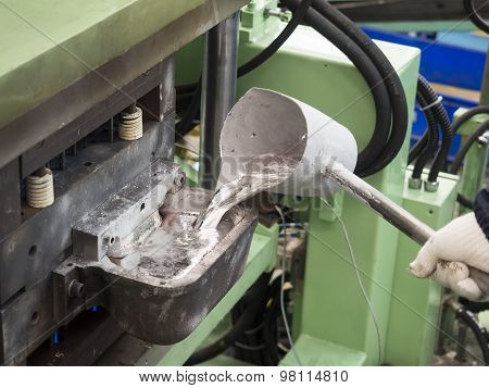 Operator Pouring Aluminum Automotive Parts