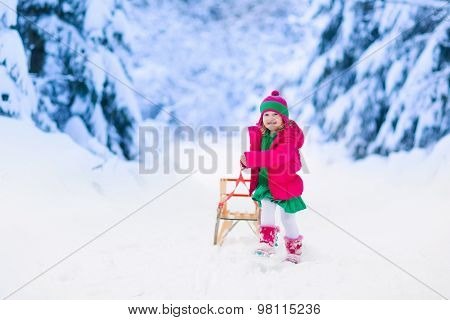 Little Girl Having Fun In Snowy Winter Park