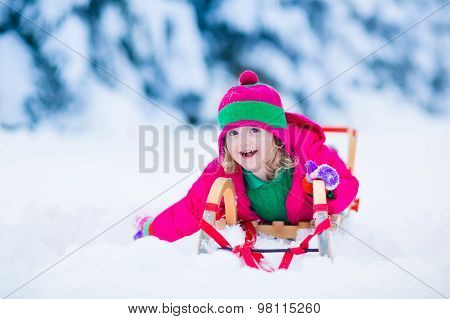 Little Girl Enjoying A Sleigh Ride In Winter