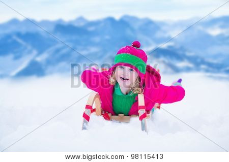 Little Girl Having Fun At Sleigh Ride
