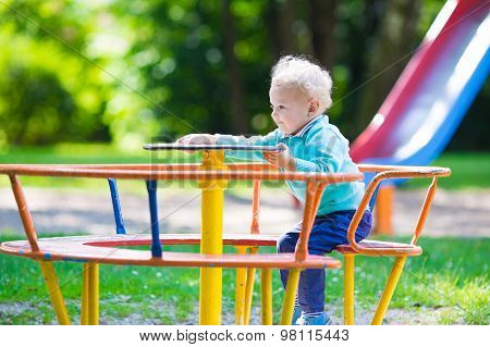 Little Boy On A Playground